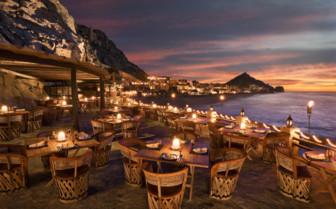 Illuminated terrace at night at Capella Pedregal