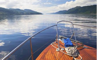 A boat cruising down the Loch Ness