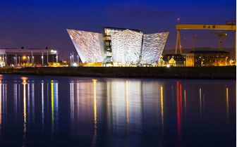 A picture of the Belfast Titanic Museum at nightfall