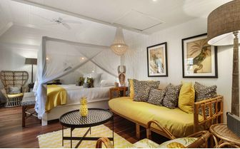 villa marie bungalow room with yellow decor