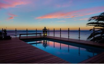 cape_view_sunset_over_pool