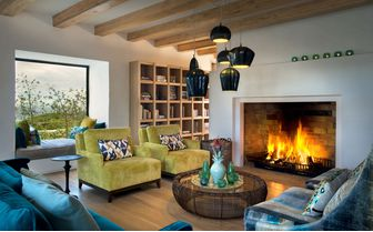 Morukuru_Ocean_House_lounge_with_fireplace