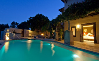 The poolside at night at the hotel