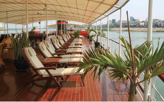 Lounge chairs on the deck of the Mekong Pandaw
