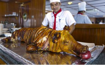 Grilled pig for dinner at Tonle Pandaw
