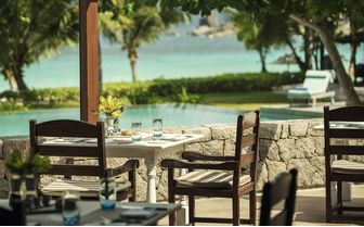 Poolside dining at Four Seasons Seychelles