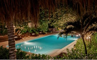 Pool in the evening at hotel Esencia