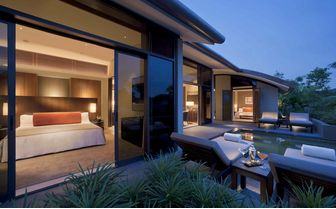 Two bedroom villa and pool at night