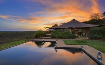 Infinity pool at Louisaba tented camp during sunset