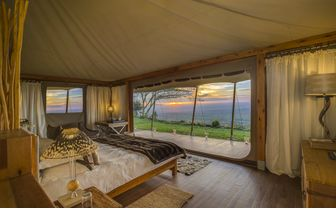 Double bed in a luxury tent with view