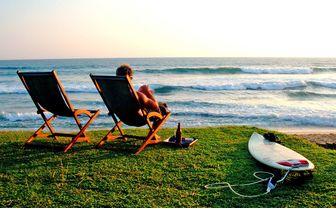 Apa Villa Thalpe surfer on the beach at sunset
