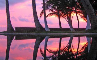 Apa Villa Thalpe Pool at sunset