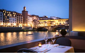 Evening meal over River Arno