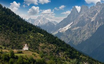 Caucasus Mountains with view of small church