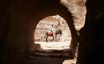 Man riding donkey