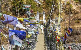 Prayer flags lining a bridge