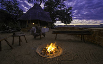Fire pit on sand with a bar
