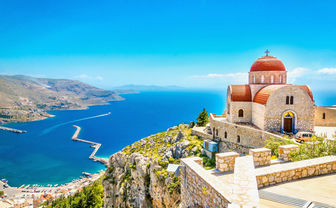 Hilltop church overlooking Crete's shores and mountains