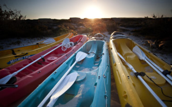 Picture of kayaks at sunset at Sal Salis, Ningaloo Reef