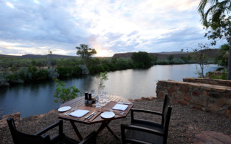 El Questro Homestead dining with a cliff top view at sunset