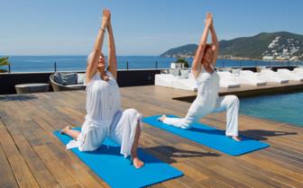 Outdoor spa area by the sea at Hotel Aguas de Ibiza, luxury hotel in Spain