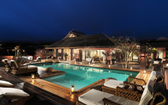 The terrace and pool area at night