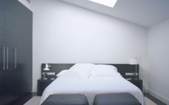 White double bedroom at Palau de la Mar