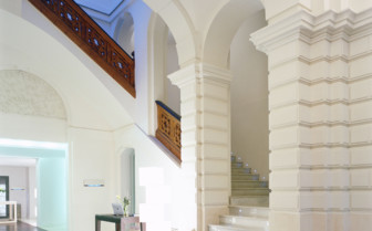 Hallway and stairs at Palau de la Mar, luxury hotel in Spain