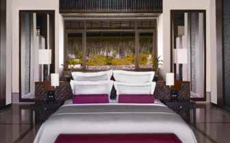 Luxury bedroom at Reethi Rah, luxury hotel in the Maldives