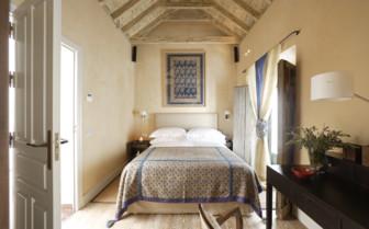 Bedroom at Corral Del Rey hotel