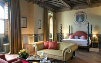 Bedroom with living area at Castello Del Nero