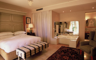 The deluxe room with garden at Villa Mangiacane, luxury hotel in Italy