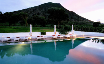 Swimming pool in the evening at Capofaro, luxury hotel in Italy