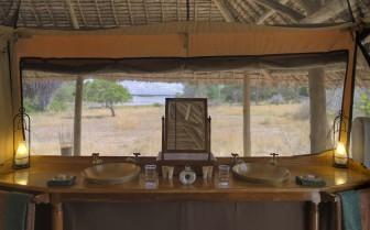 Bathroom suites at Siwandu, luxury camp in Tanzania