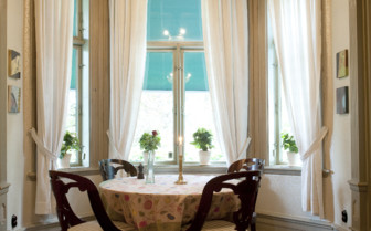 Dining table at Villa Sjotorp, luxury hotel in Sweden