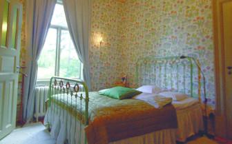 Bedroom at Villa Sjotorp, luxury hotel ion Sweden