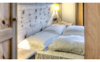 Bedroom at Ciasa Antersies, luxury hotel in Italy