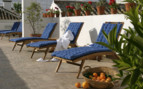 Terrace area with sun chairs at the hotel