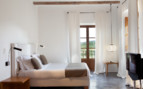 Light bedroom at Son Brull, luxury hotel in Italy