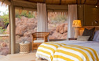Bedroom at Mowani, luxury camp in Namibia