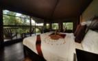 Bedroom at Little Kwara Camp, luxury camp in Botswana
