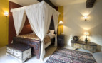 Bedroom at Mihir Garh, luxury hotel in India