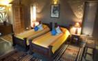 Twin bedroom at Forsyth's Satpura, luxury hotel in India