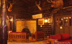The lounge with fireplace at El Tovar, luxury hotel in the Great American Wilderness