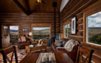 The living room area with panoramic views at Brush Creek Ranch