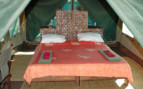 Double bed in tent at Mdonya Old River Camp