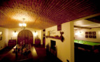 Cellar with bar and pool table at The Manor