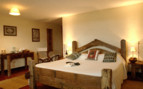 Luxury bedroom at Ndutu Safari Lodge, luxury lodge in Tanzania