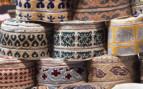 Omani Caps Piled at a Market