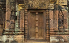 A Doorway Surrounded by Carvings at Siem Reap